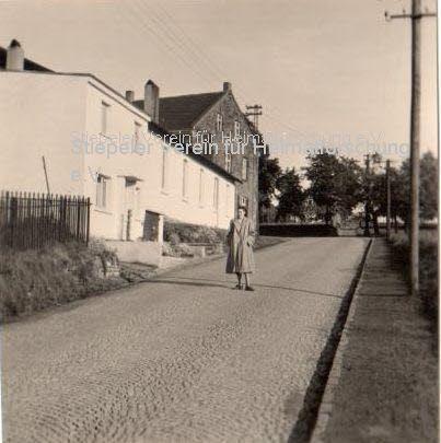 Blick von der Surkenstraße 1944, mit Haushaltswarengeschäft Kestermann